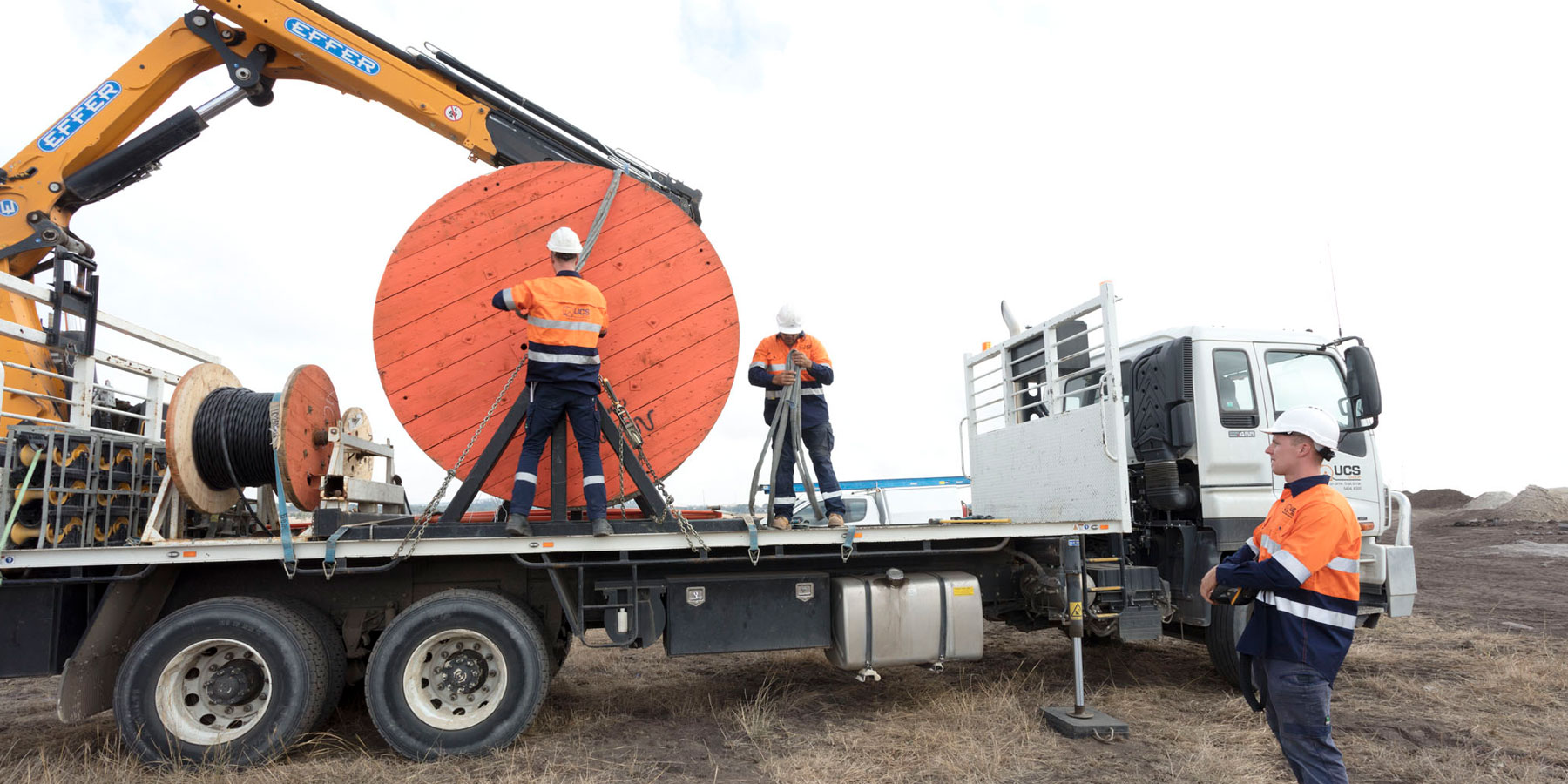 UCS Workmen preparing cable on back of truck
