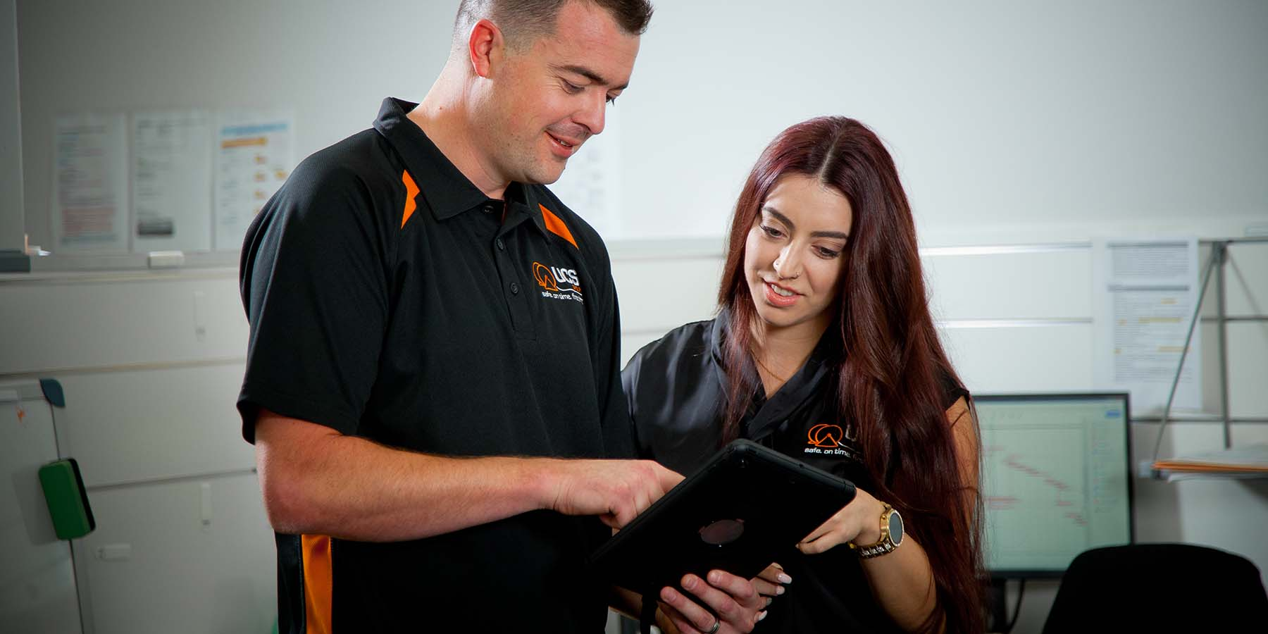 UCS man & woman looking at tablet